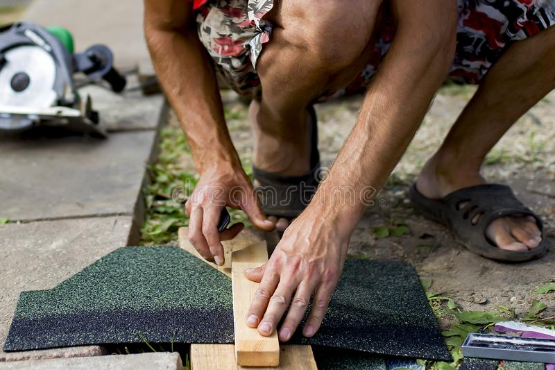 Man doing repairs in the country. A man doing repairs in the country stock photography