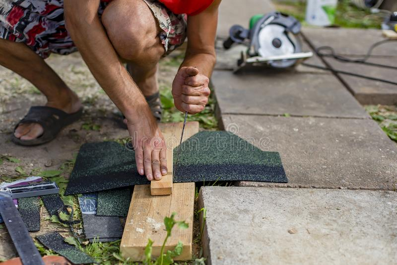 Man doing repairs in the country. A man doing repairs in the country royalty free stock photo