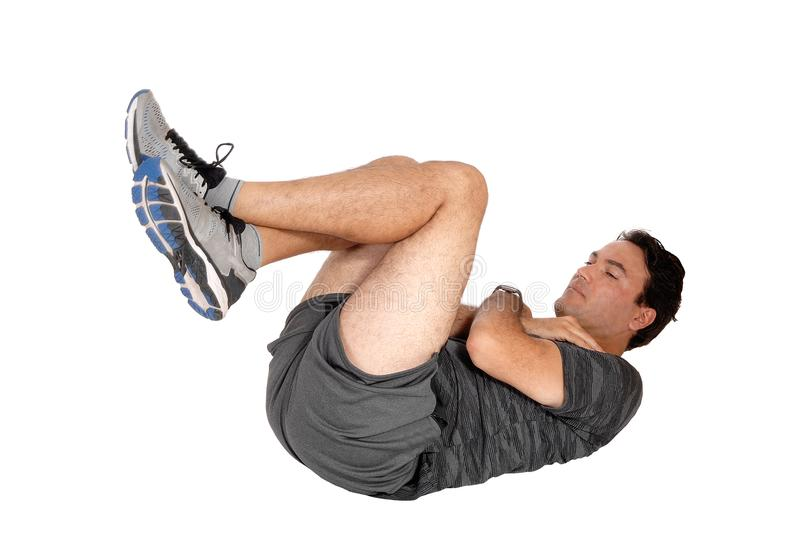 Man doing sit-ups on the floor royalty free stock photos