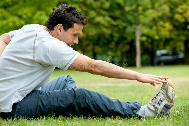 Download Man Doing Stretching Exercises Stock Photo - Image: 12391092
