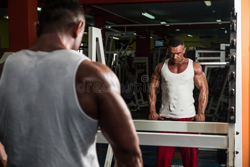 Man Doing Trap Exercises royalty free stock image
