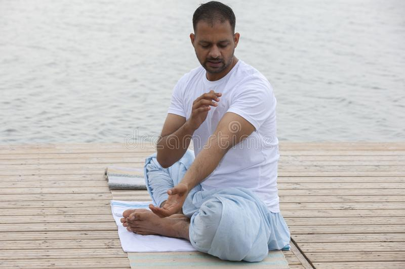 Man doing yoga exercise in the morning stock photos