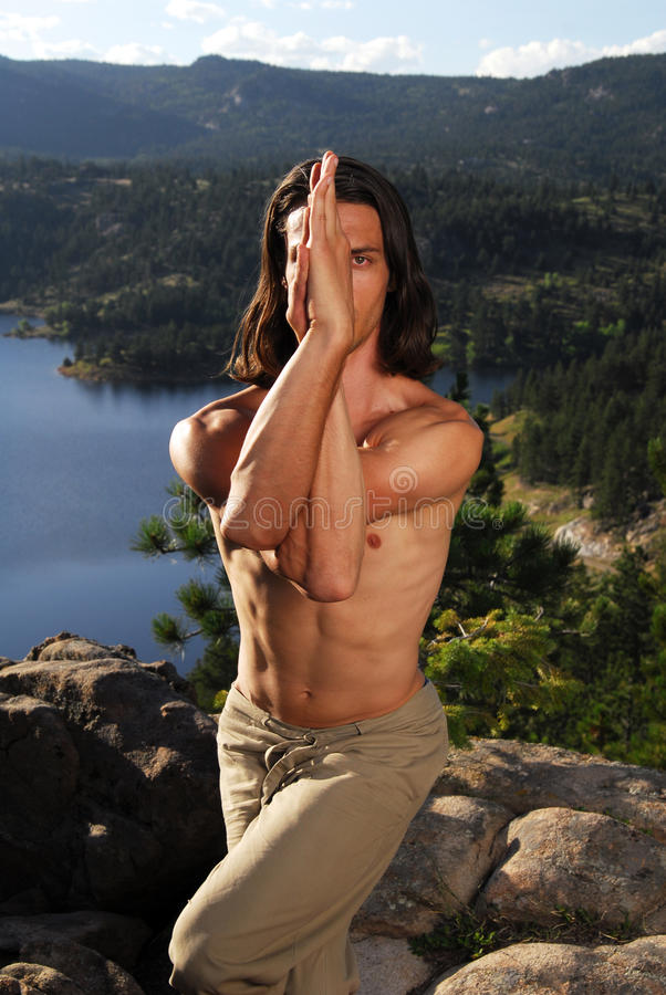 Download Man Doing Yoga On A Mountain Top Stock Photo - Image: 10396118