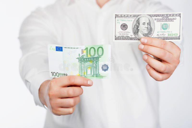 Man with dollar and euro stock photography