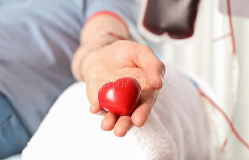 Man donating blood to save someone`s life. In hospital royalty free stock image