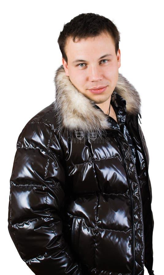 Man in down-padded coat stock image