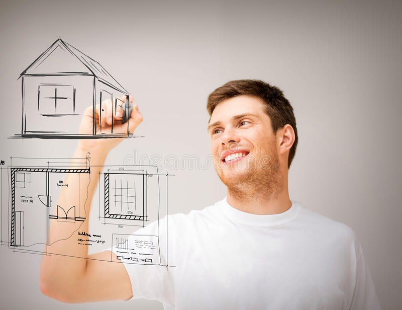 Man drawing blueprint on virtual screen. Real estate, technology and accomodation concept - man drawing house and blueprint on virtual screen royalty free stock photos
