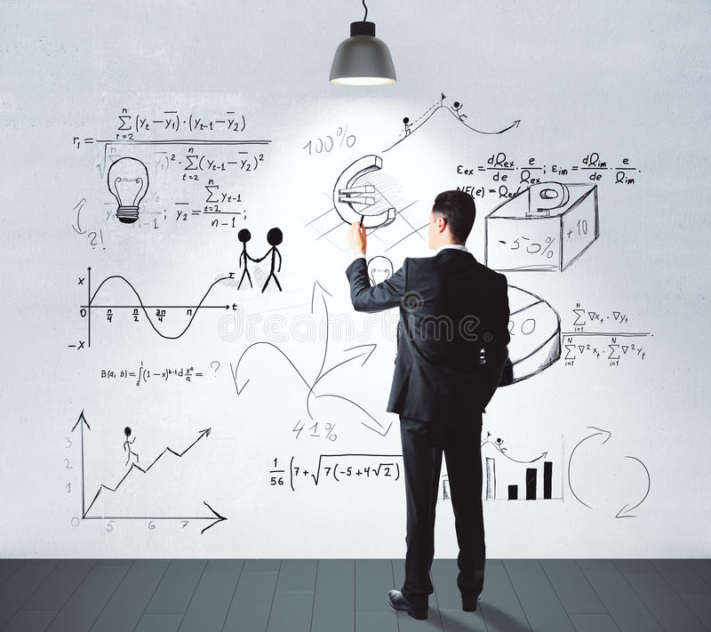 Man drawing business idea concept on white wall in empty. Businessman drawing business idea concept on white wall in empty room stock images
