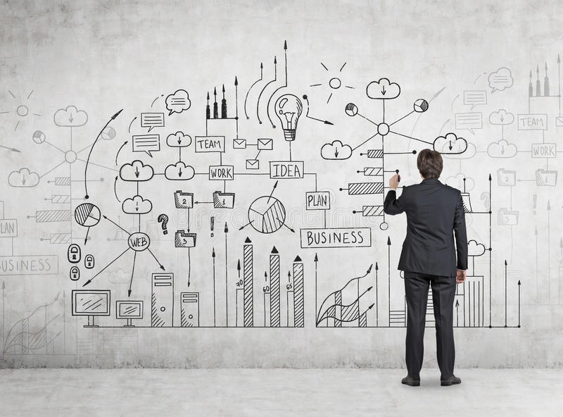 Man drawing a business scheme on cocncrete stock images