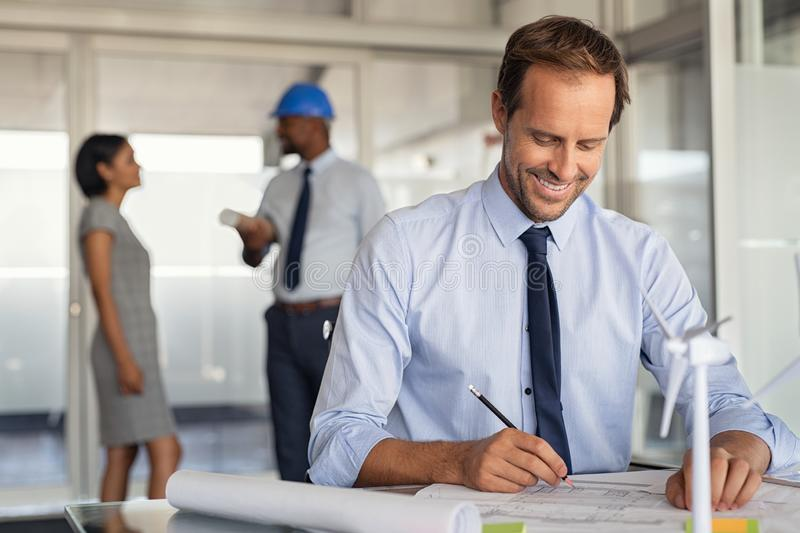 Man drawing eco sustainable architecture plan stock photo