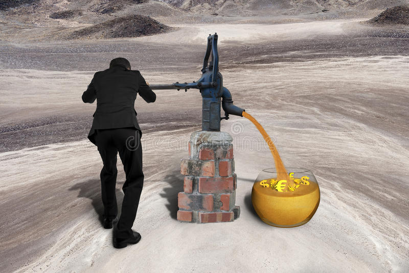 Man drawing golden sand currency symbols retro pump desert. Man drawing out golden sand with 3D currency symbols from retro water pump on the desert background royalty free stock photo