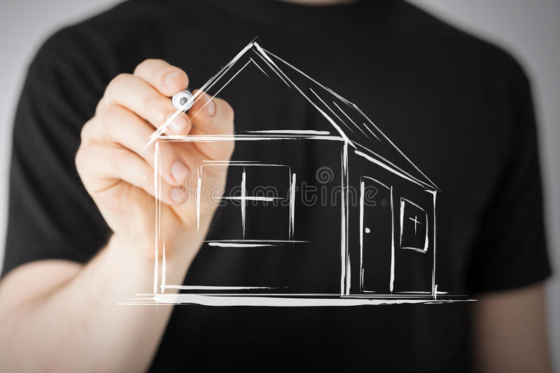 Man drawing a house on virtual screen royalty free stock images