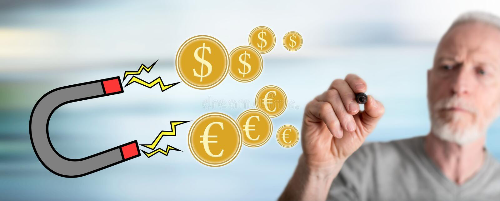 Man drawing money attraction concept stock photo