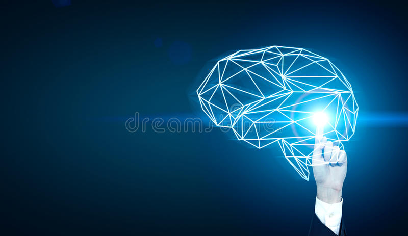 Man drawing polyginal brain. Brainstorming concept with businessman hand pointing at abstract illuminated polygonal brain on dark blue background royalty free stock photography