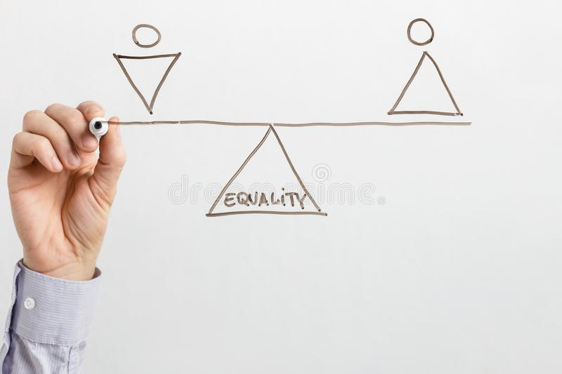 Man drawing seesaw with equal male and female figures stock photos