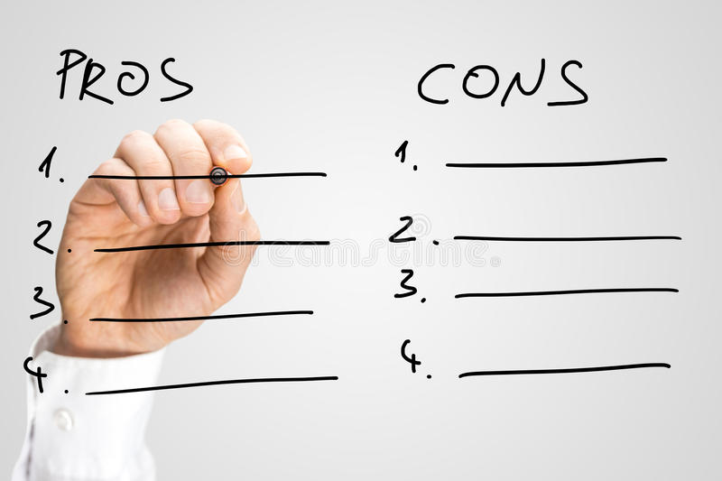Man drawing up a list of pros and cons. On a virtual interface or screen with a marker pen in order to make a decision in a conceptual image, close up view of royalty free stock photo