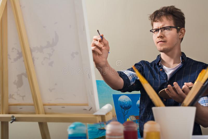 The man draws a picture. The man nursed drawing. The artist draws a picture royalty free stock photos