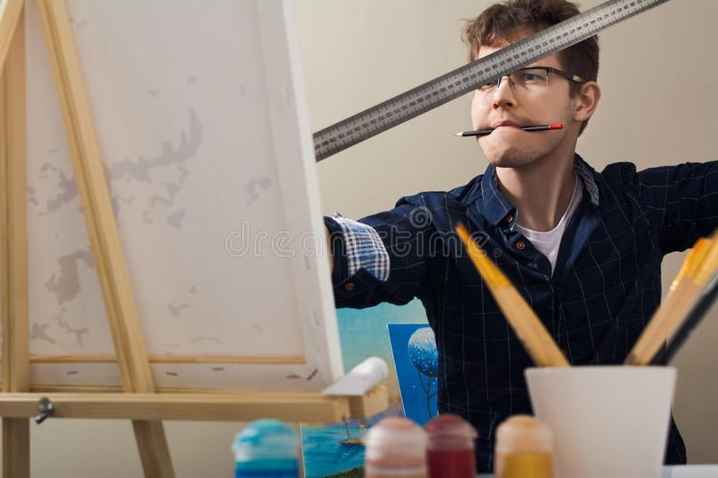 The man draws a picture. The man nursed drawing. The artist draws a picture royalty free stock photo