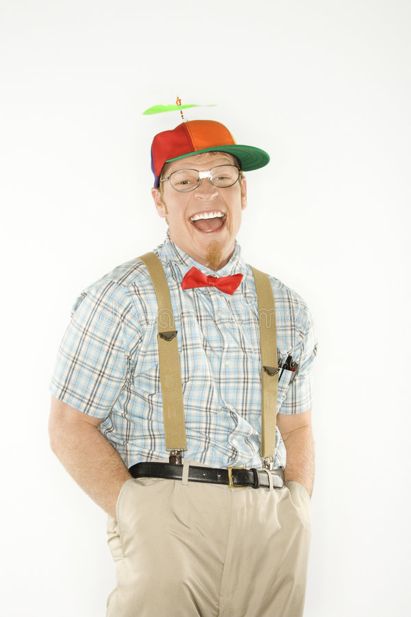 Man dressed as nerd with hands in pockets. royalty free stock photos