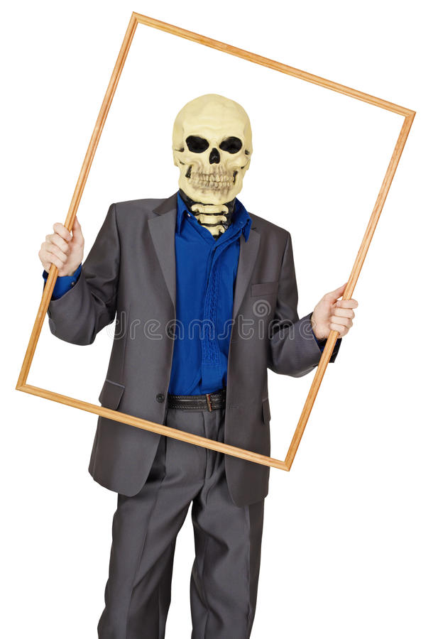 Man dressed as skeleton in wooden frame. A man dressed as a skeleton in a wooden frame on white background stock images