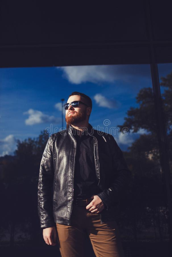 Man dressed in black leather jacket royalty free stock photography