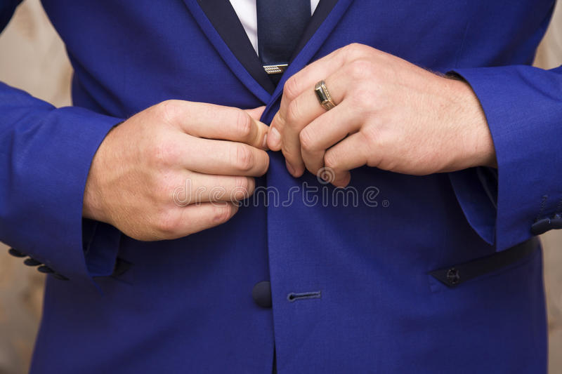 Man dressed in blue suit and white shirt. Close-up of elegance male hands. man dressed in blue suit and white shirt. groom or businessman royalty free stock images