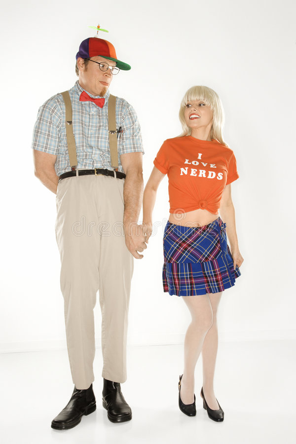 Free Man Dressed Like Nerd Holding Hands With Woman. Stock Photography - 2037442