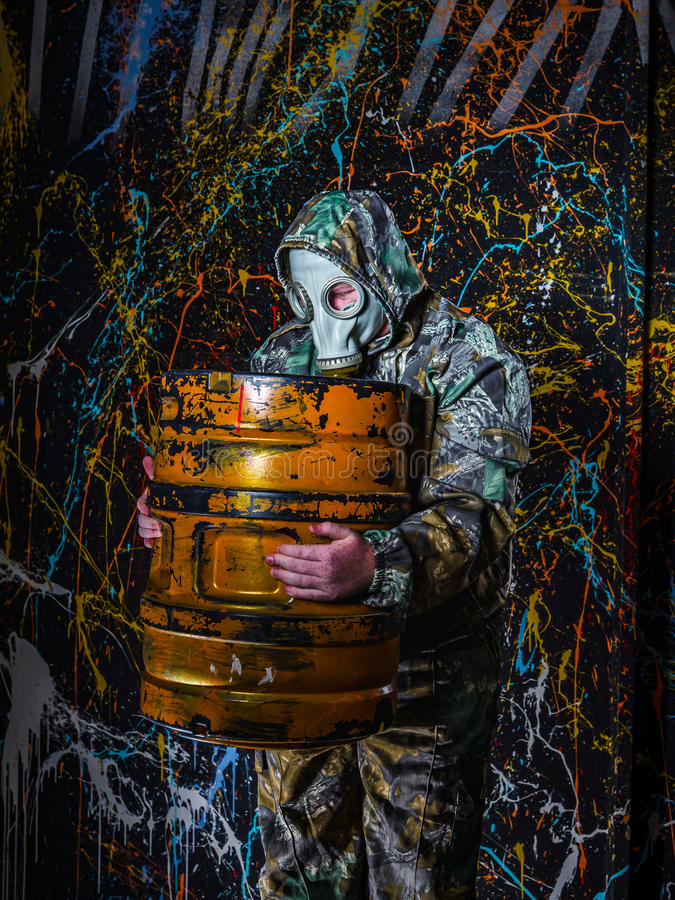 Man dressed into military wear and gas mask, ecology and toxic c. Oncept, studio light royalty free stock images