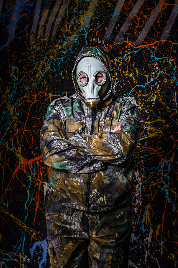 Man dressed into military wear and gas mask, ecology and toxic c. Oncept, studio light royalty free stock photos