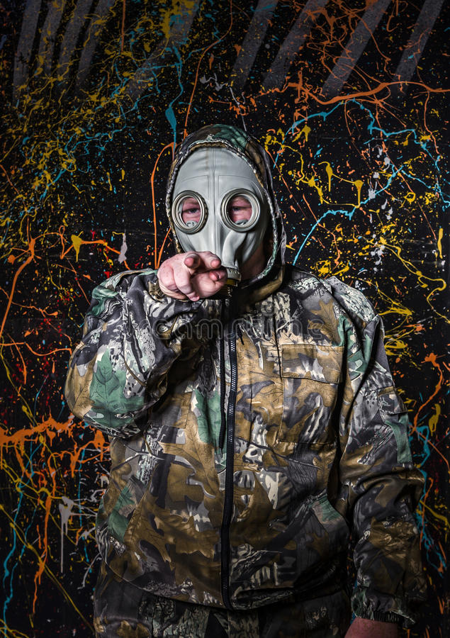 Man dressed into military wear and gas mask, ecology and toxic c. Oncept, studio light stock image
