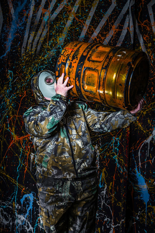 Man dressed into military wear and gas mask, ecology and toxic c. Oncept, studio light royalty free stock photo