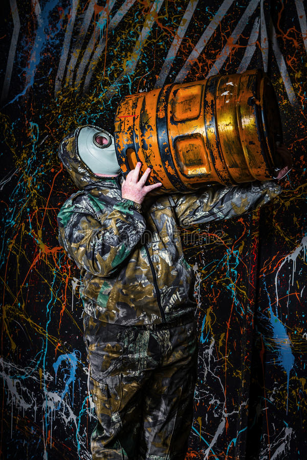 Man dressed into military wear and gas mask, ecology and toxic c. Oncept, studio light stock photos