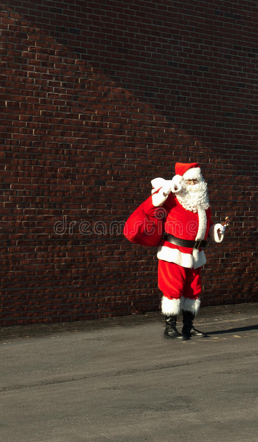 Download Man dressed in santa suit editorial stock photo. Image of wall - 22544783