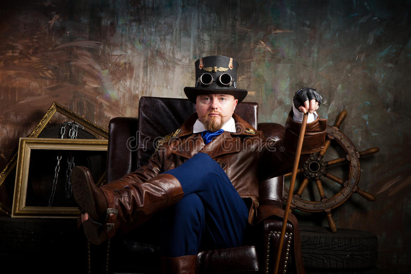 A man dressed in the style of steampunk royalty free stock image