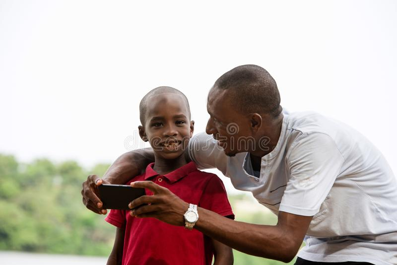 Portrait of a man and his child, happy royalty free stock image