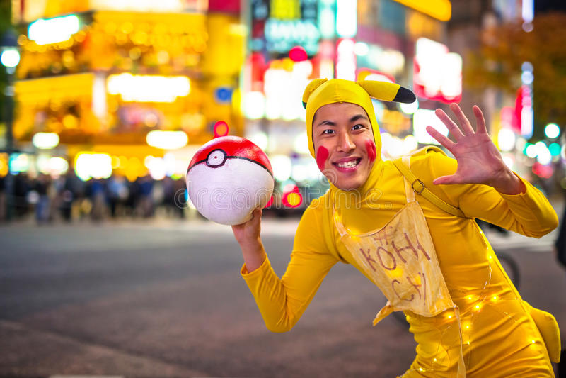 Man dressed up like Pikachu at Shibuya crosswalk in Tokyo royalty free stock image