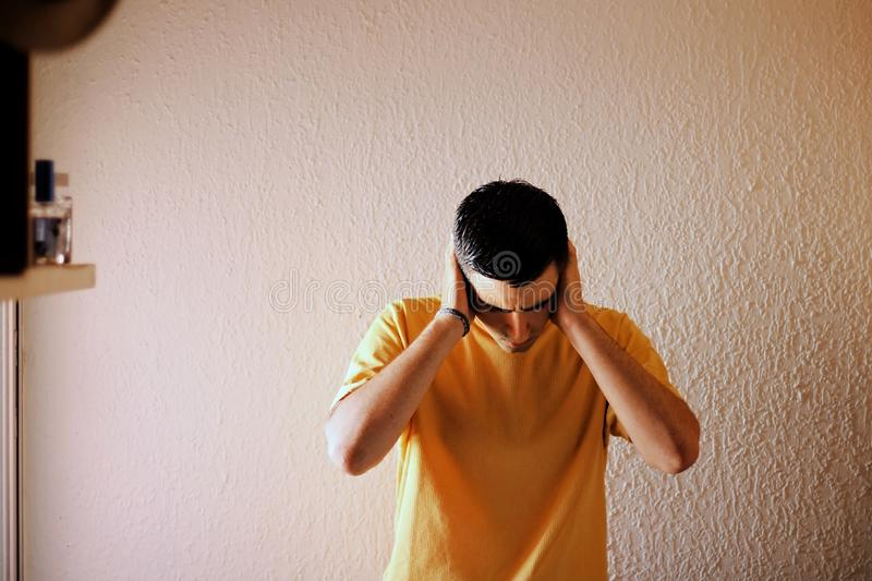 Man dressed in yellow with a headache. royalty free stock photography