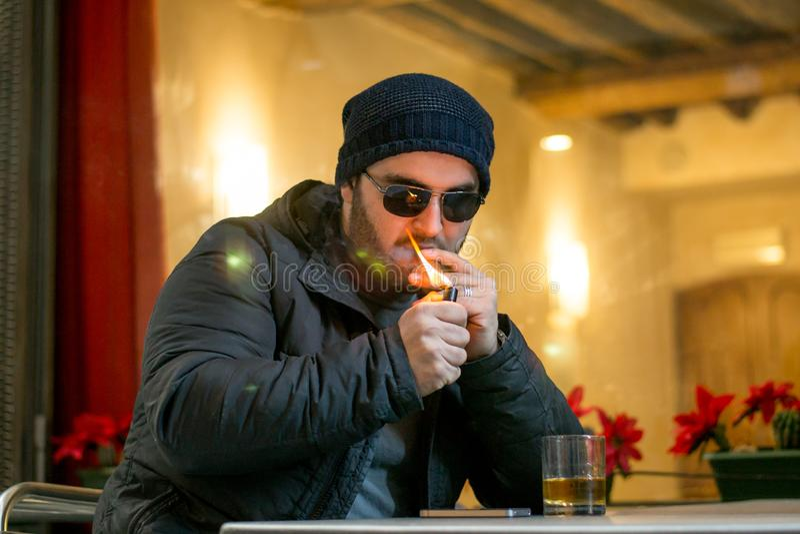 An albanian mafia buy is lighting a cigar stock images