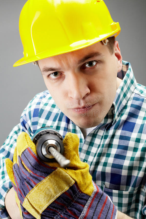 Download Man with drill stock photo. Image of person, looking - 20095754