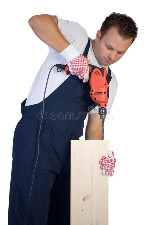 Man drilling. Man holding a drill on a peace of wood plank royalty free stock photography