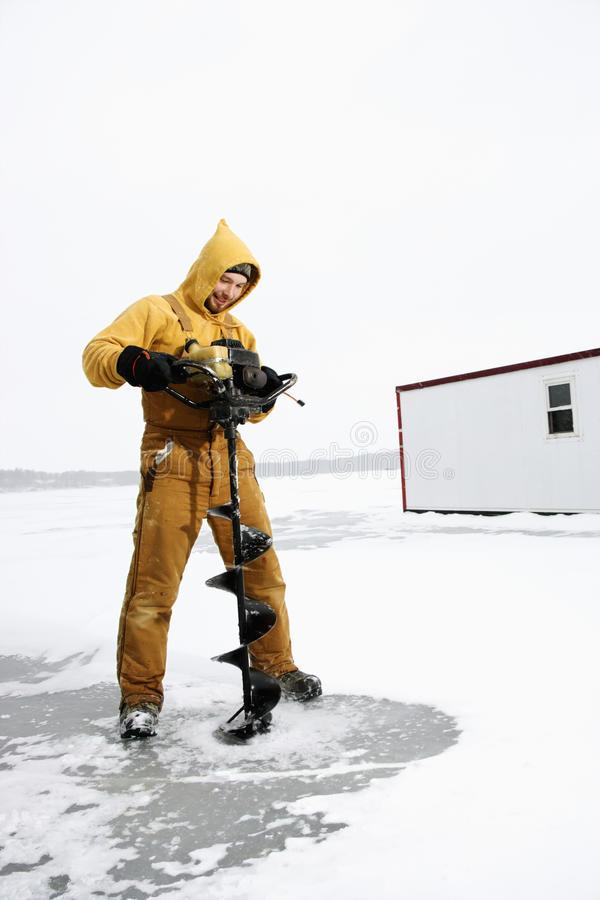 Download Man Drilling Hole in Ice stock image. Image of activity - 12732745