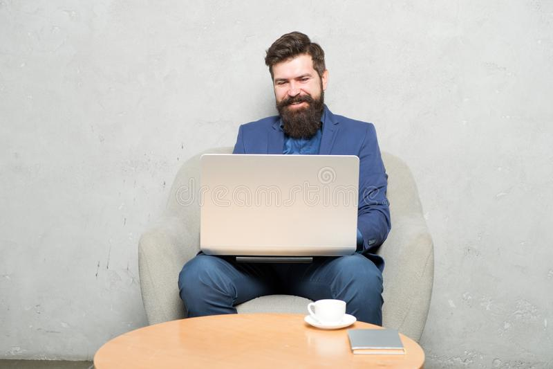 Man drink coffee in business office. Responding business email. Digital marketing. Surfing internet. Buy online. Project. Manager. Business correspondence stock image