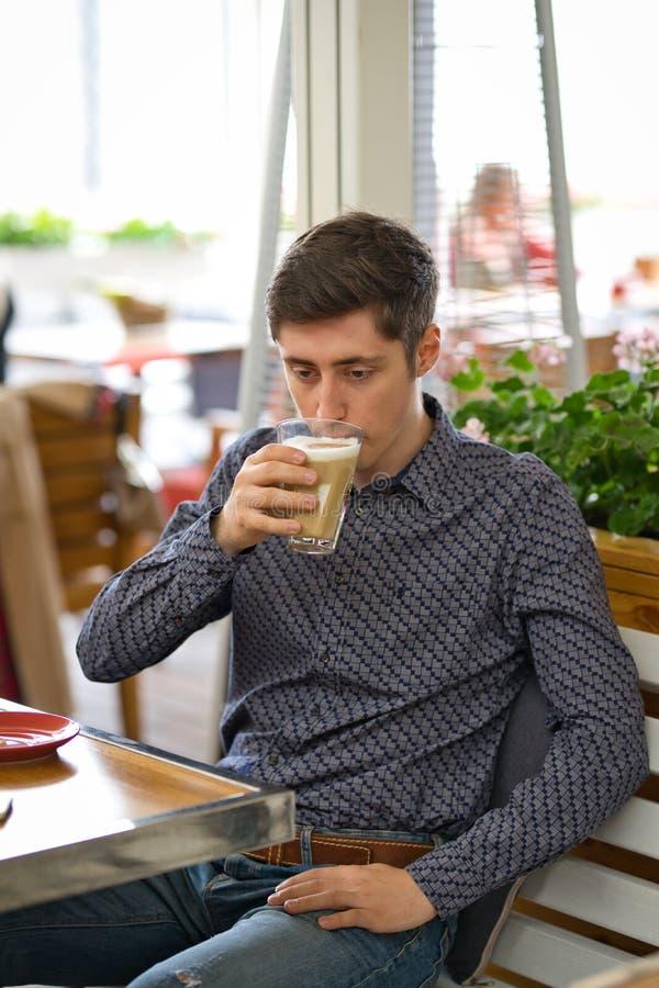 Man drink large latte coffee royalty free stock photo