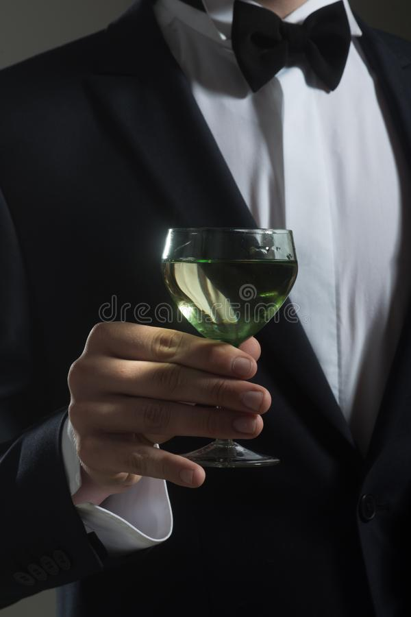 Man drink wine. wedding. Bride groom on husband with glass. successful business meeting. Deal. formal male fashion stock images