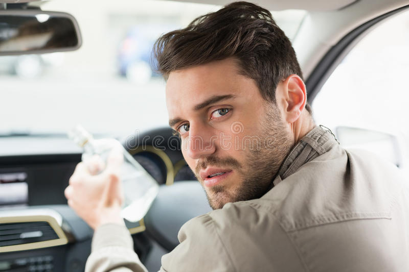 Man drinking alcohol while driving stock images
