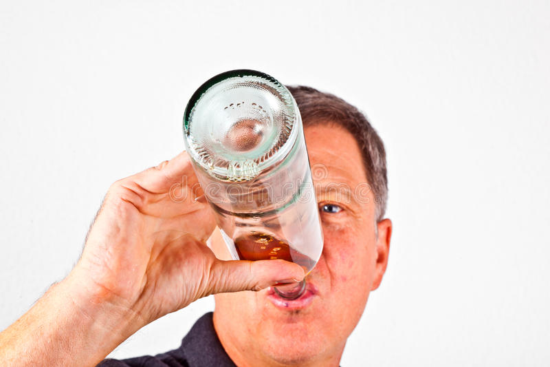 Man drinking alcohol out of bottle stock photos