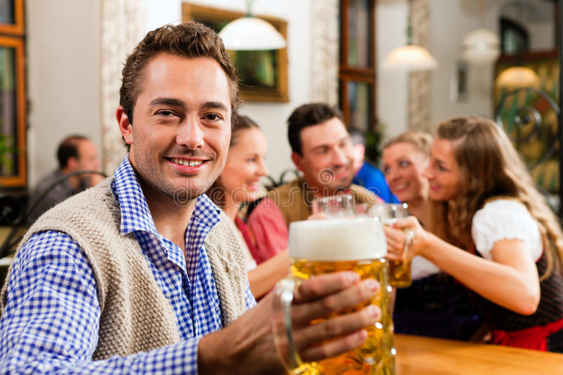 Man drinking beer in Bavarian pub royalty free stock photography