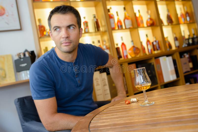 Man drinking beverage alone stock photos