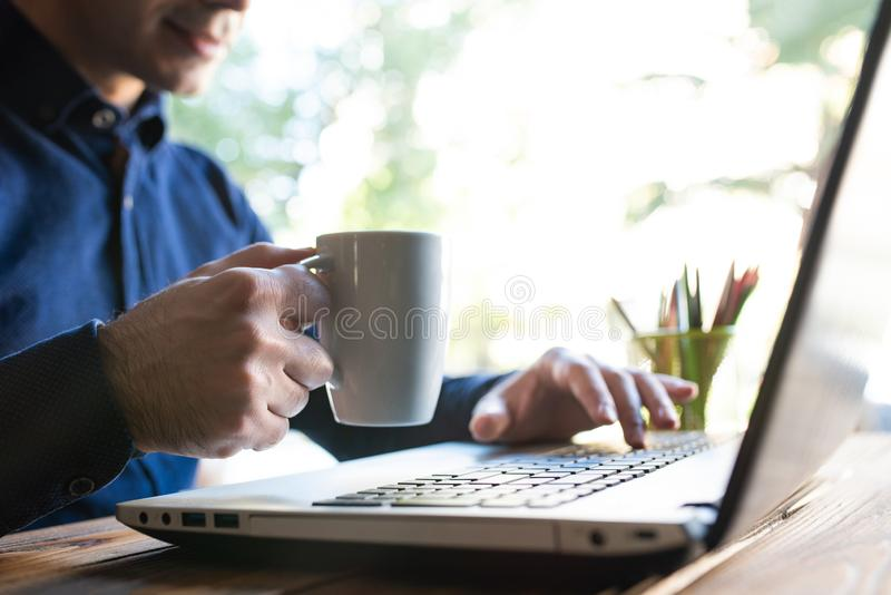 Man Drinking Coffee In Office royalty free stock photography