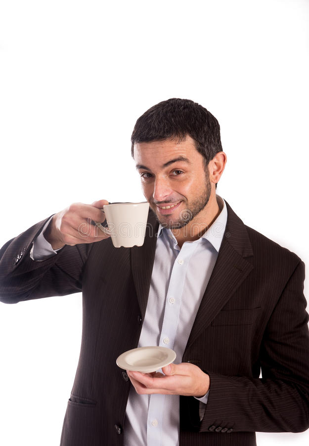 Man Drinking Coffee In A Suit Stock Photo